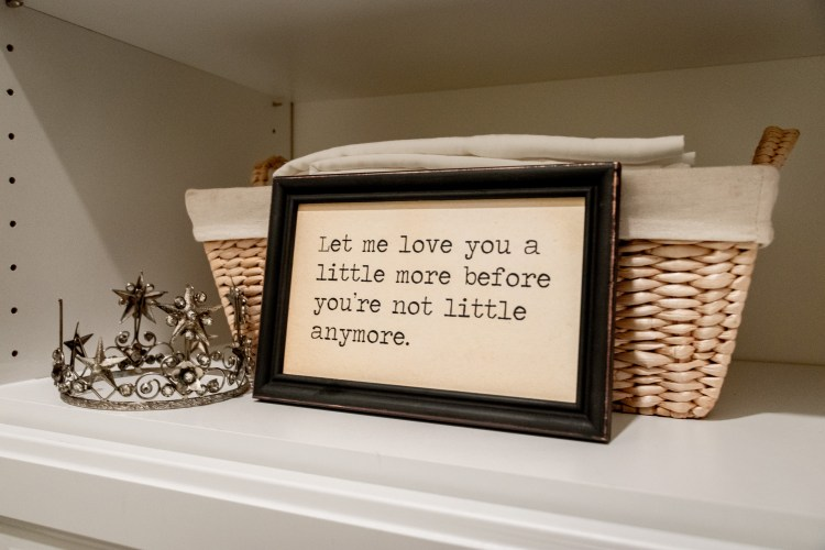 small crown, quote and basket in a closet, organize your closet