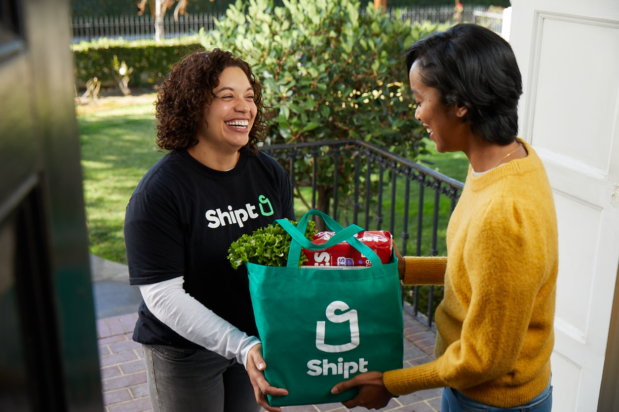 shipt delivery woman delivering groceries to another woman