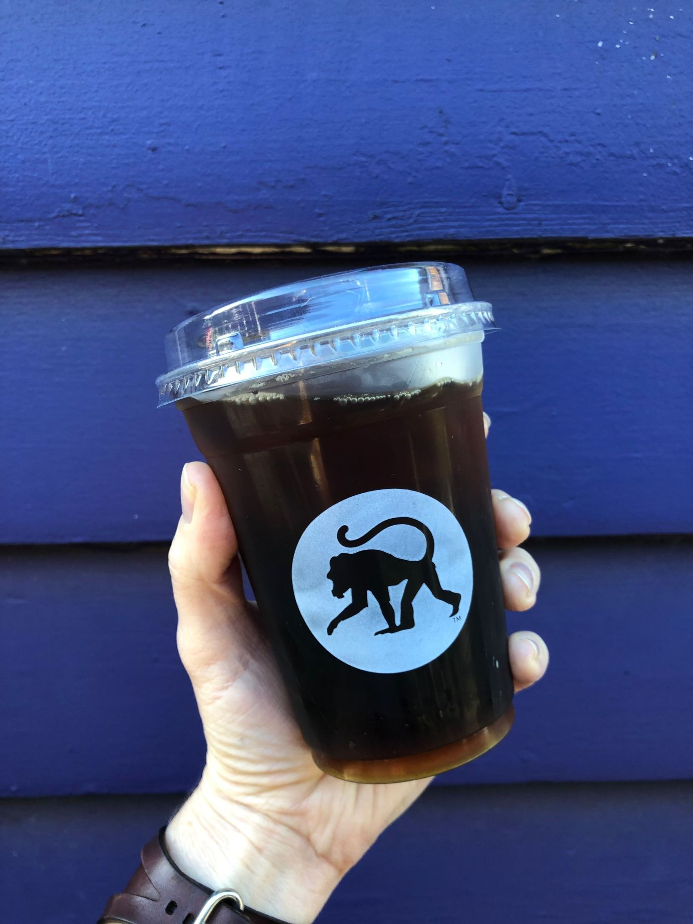 cup of coffee with frothy monkey logo