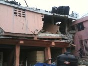 PHOTO: House split in half in Haiti. marvinady/twitpic