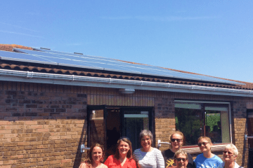 Investing In Community Energy Banner Image - Celebrating New Solar Panels at Community Centre