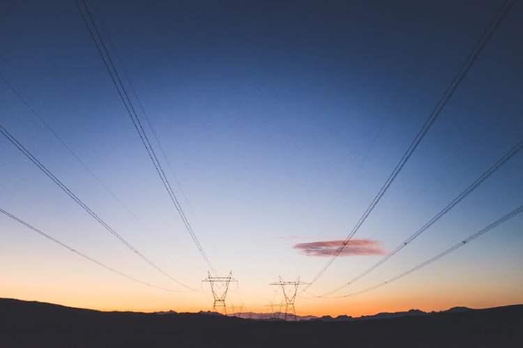 Coronavirus clean energy economics - electric transmission pylones - NeOONBRAND - UnSplash
