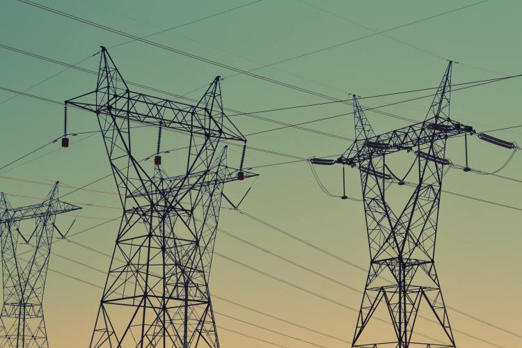 UK electricity transmission and distribution network infrastructure at sunset
