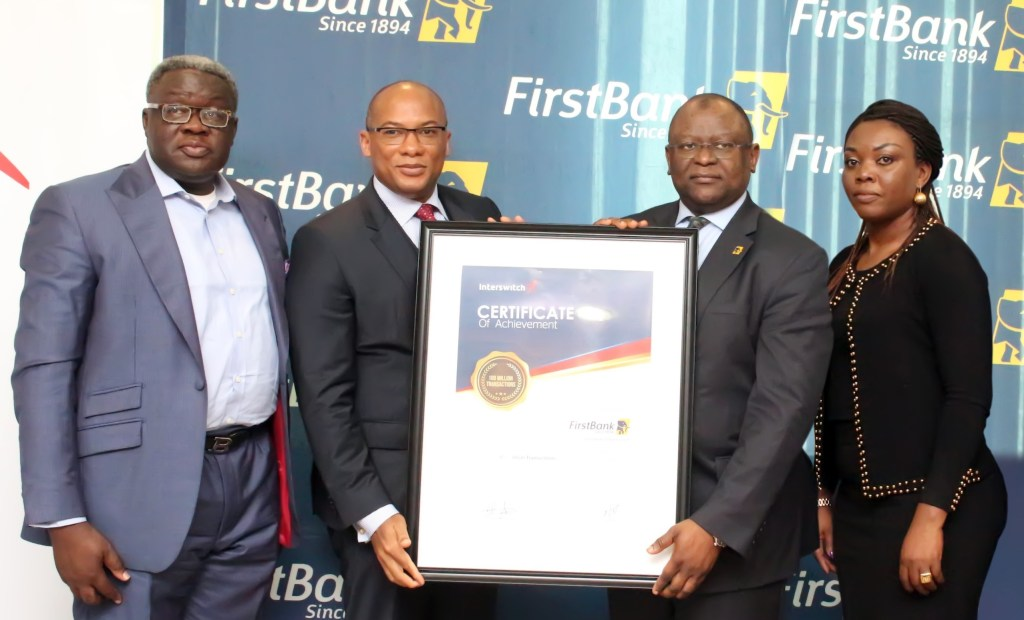 L-R:  Dr. Remi Oni, Executive Director, Corporate Banking (FirstBank); Mitchell Elegbe, Group Managing Director/CEO, Interswitch; Dr. Adesola Adeduntan, Managing Director/CEO, FirstBank (Nigeria) and Cherry Eromosele, Chief Marketing Officer, Interswitch Group, during the official recognition of FirstBank 100 million transactions milestone by Interswitch at FirstBank Headquarters in Lagos.