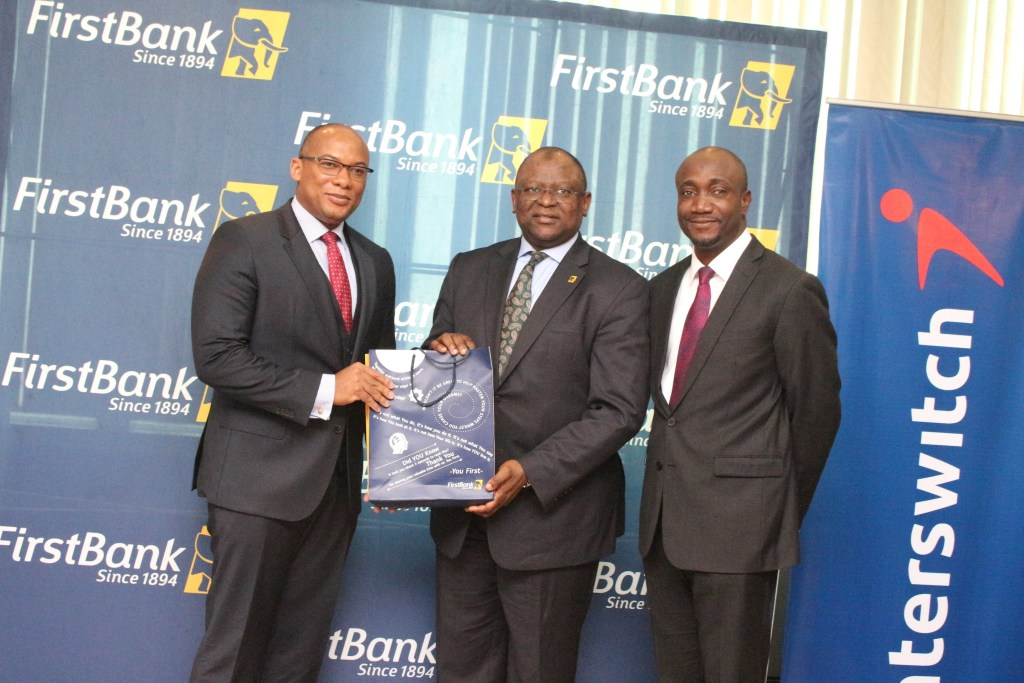 L-R: Mitchell Elegbe, Group Managing Director/CEO, Interswitch;  Dr. Adesola Adeduntan, Managing Director/CEO, FirstBank (Nigeria)  and Mr. Charles Ifedi, Divisional CEO, Consumer Segments, Interswitch, during the official recognition of FirstBank 100 million transactions milestone by Interswitch at FirstBank Headquarters in Lagos recently.