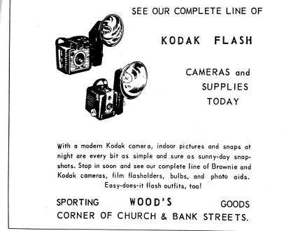 A 1939 advertisement let readers know that Woods Sporting Goods carried a complete line of Kodak flashes.