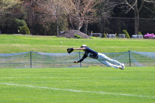 Senior Will Currell dives for a fly ball in left during a game this season at Buck Hard Field. | Photo: OREAD