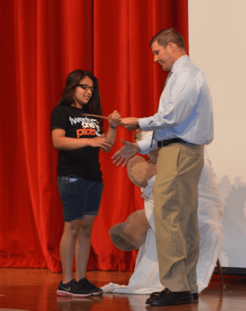 Principal Sullivan hands out the National Latin Exam awards to Mr. Stringer's latin students