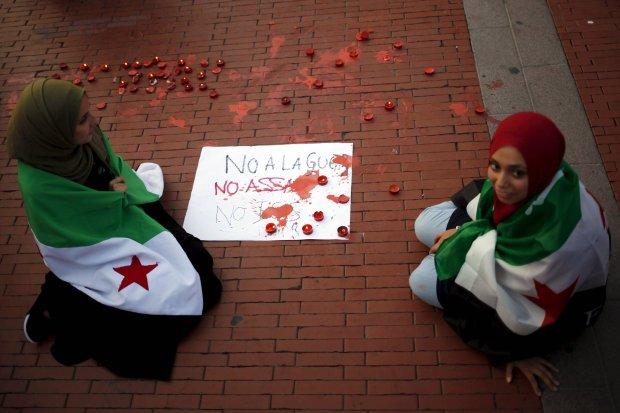 Kobiety związane z syryjską opozyją prostestuja przeciwko wojnie, Assadowi i ISIS