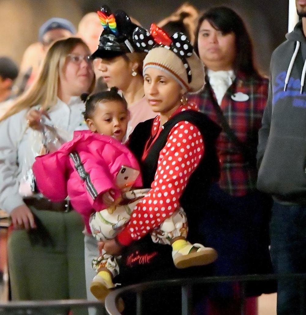 Cardi B at an amusement park with her daughter
