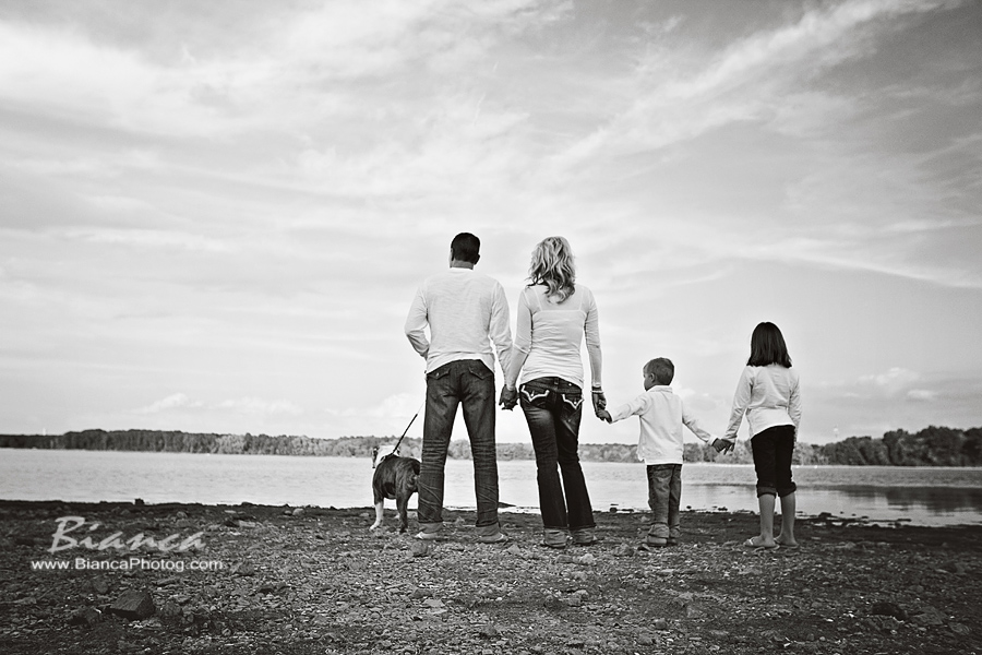 Family gazing out at the beach