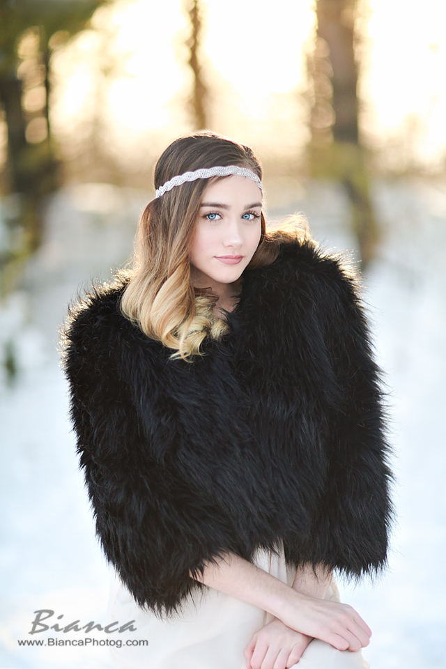 beautiful senior with headband and black fur in fashion shoot
