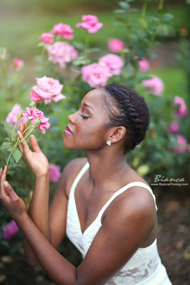 Senior with flowers at Mill Creek Park