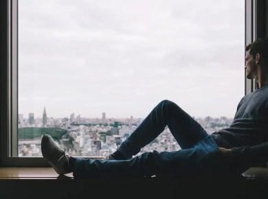 Man Thinking on Window