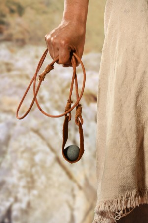 Hand of David holding slingshot with stone