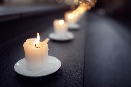 Candles on alter steps in a church religion concept