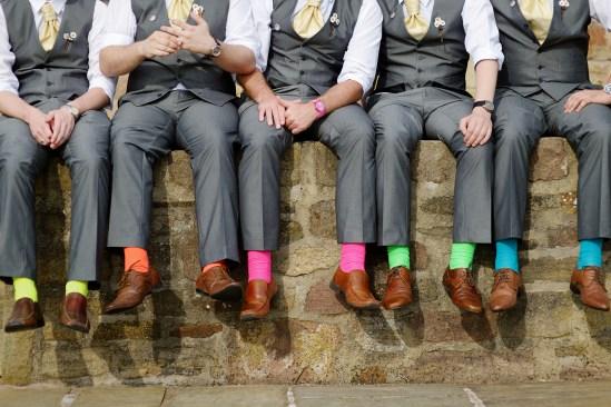 Funny colorful socks of groomsmen on summer day