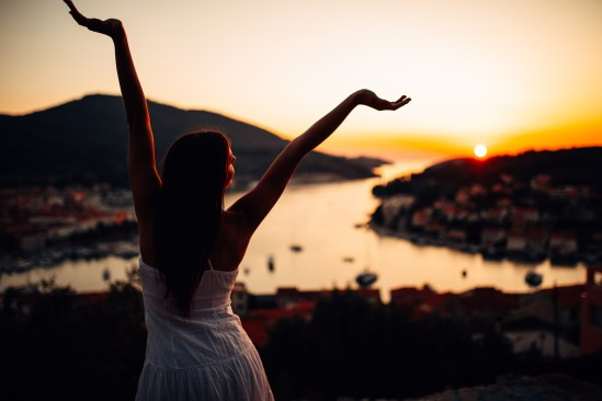 Carefree Woman Enjoying In Nature,beautiful Red Sunset Sunshine.