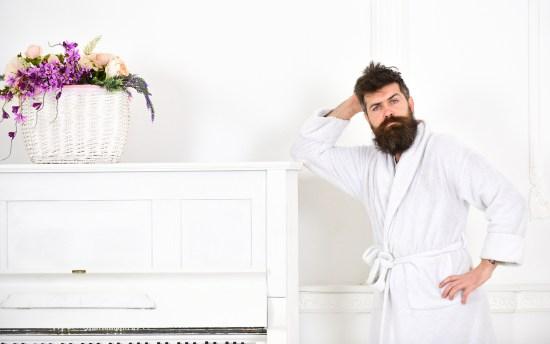 Talented Musician Concept. Man With Beard In Bathrobe Enjoys Mor