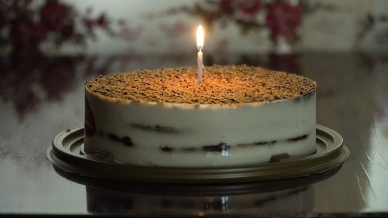 Birthday Cake With Colorful Burning Candle In Dark. Cake: Birthd