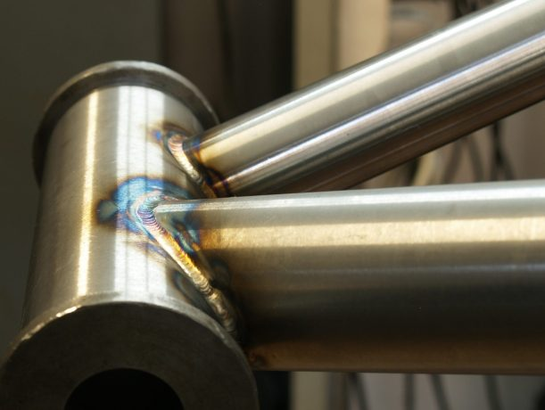tig welding on a heatube of a custom made bicycle frame
