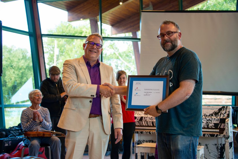 CMC BC Director presents Casse-Tête Festival Founder Jeremy Stewart with CMC Certificate of Excellence