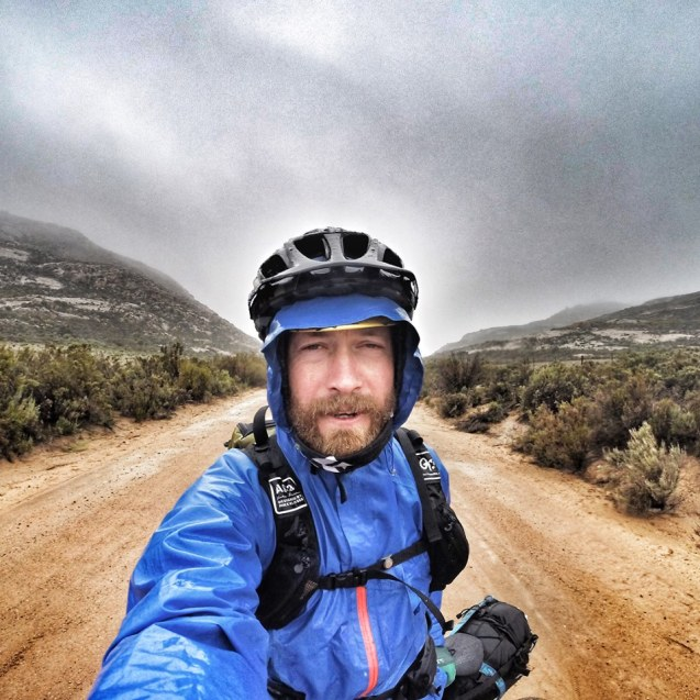 Zane riding through a storm on his way to Leliefontein. Photo by Zane Schmahl.