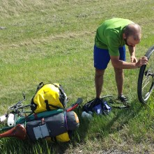 Chris got a flat tire just outside Calgary, on a physically draining and defeating day