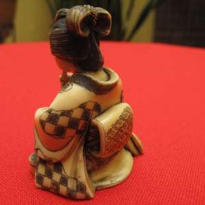 Antique carved japanese ivory Netsuke of a woman smoking his pipe