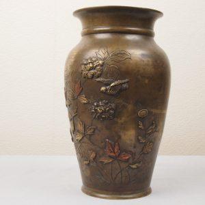 Japanese multi color bronze relief vase.