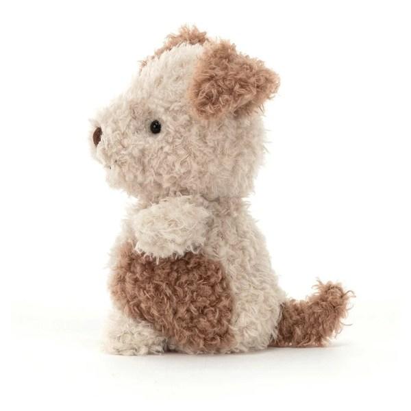 La peluche Little Pup a une texture très douce et tient bien assise.