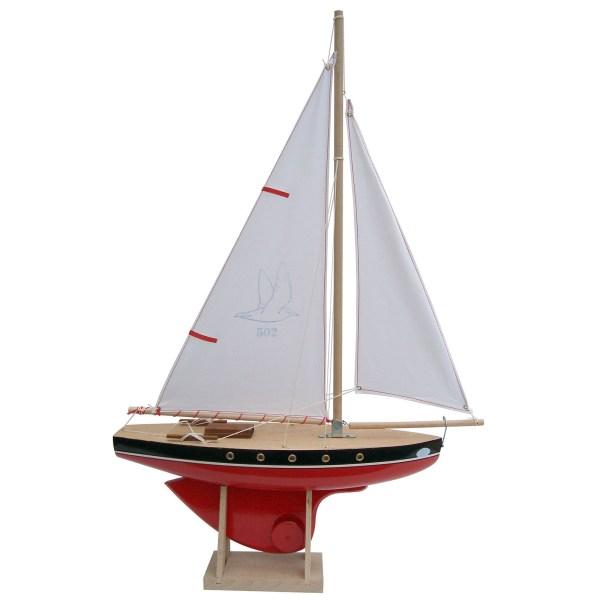 Voilier en bois à quille ronde avec une taille de 40cm et une coque rouge