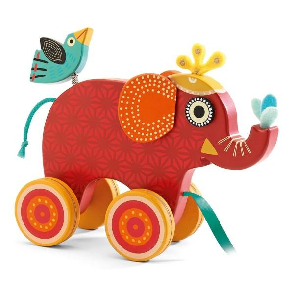 Éléphant Indy à tirer en bois de couleur rouge foncé avec motifs un oiseau en bois sur ressort sur son dos oreilles en tissu