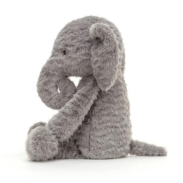 Rolie Polie tient bien assis sur son derrière et peut ainsi s'installer dans le coin de la poussette ou du berceau.