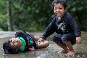 kids-playing-rain-under-filipino