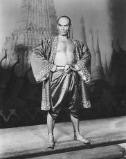 "Photo of Yul Brynner on the set of ""The King and I."""