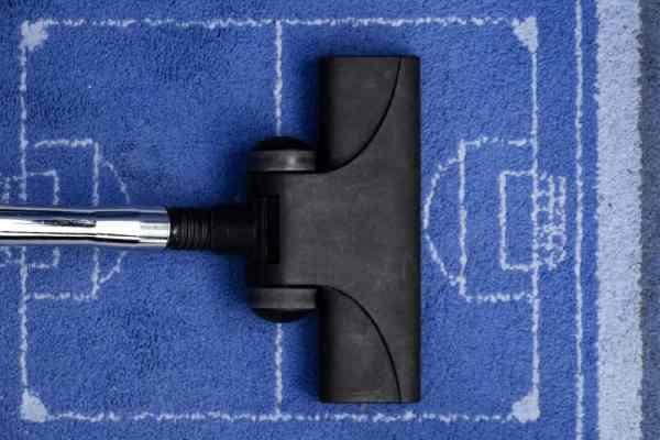 aspirateur sur tapis de sport