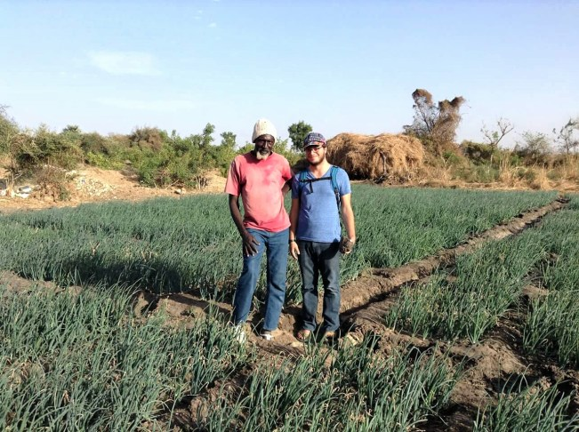 My uncle, Mbagnick Dione, and I at his fields