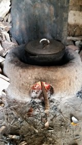 An improved mud stove in use