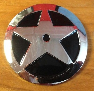 DC Direct Starman Badge.jpg