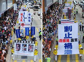 圖5.制止迫害的遊行,吸引廣大民眾和旅客的關心與圍觀,紛紛舉起相機、手機拍照。
