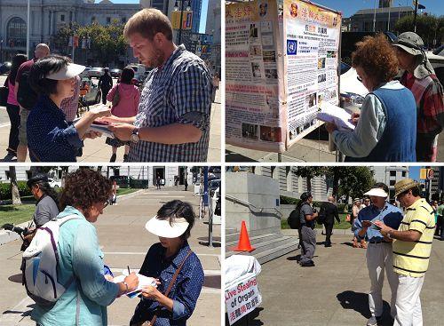圖5:當天的活動吸引了不少民眾駐足了解法輪功真相,並紛紛簽名支持「281決議案」。