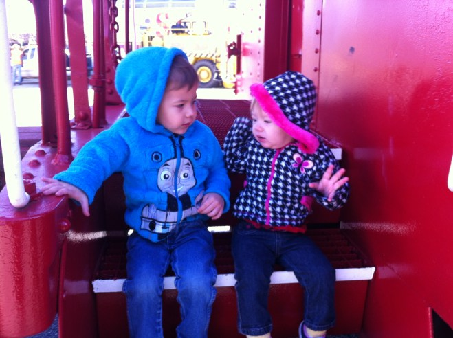 Sitting on the steeps of a caboose at the Oklahoma Railway Museum. Notice the Thomas jacket.