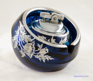 Stunning ashtray and lighter set with Sterling Silver and original labels.