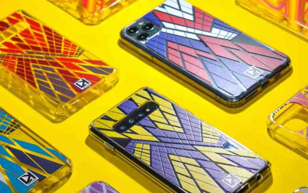 Phone cases in superhero colours are lined up across a yellow background