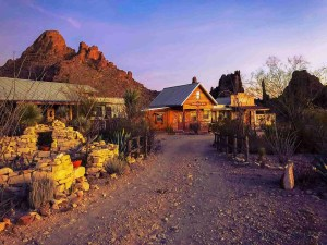 Ten Bits Ranch with desert views behind it at sunset
