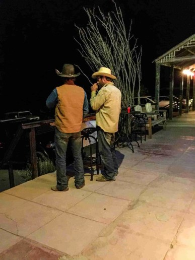 real cowboy locals enjoying the famous porch in front of starlight theatre in terlingua texas ghost town