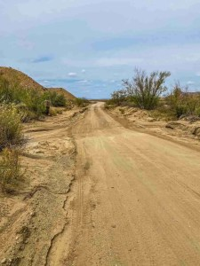 Old Maverick Road with sandy creek bed