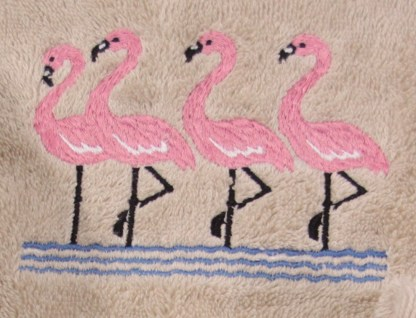 Group of Flamingos on Embroidered Bath Towels