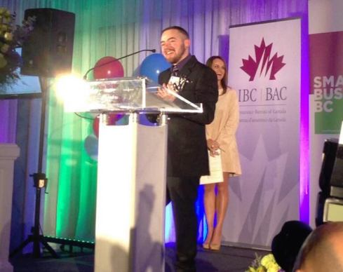 Jessie accepts his award at the Small Business BC Awards